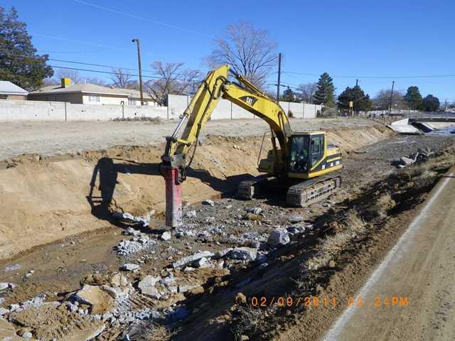 Removing concrete lining west of California bridge