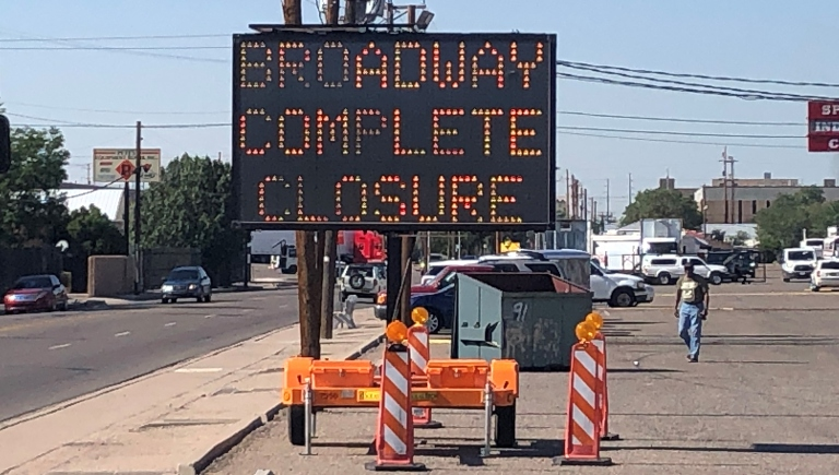 Traffic control sign announcing closure on Broadway Blvd.