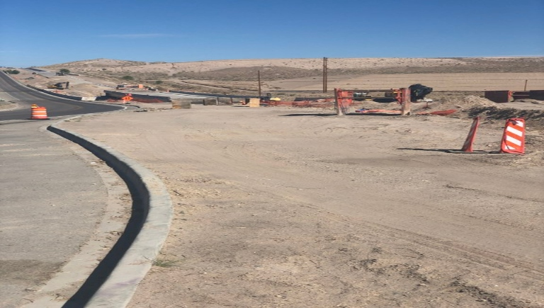 Construction crews work on the bring to Mesa Del Sol and widen the roadway.