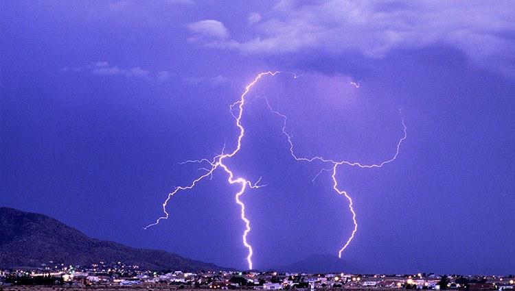 A jpg of blue lightning over the Sandias at night.