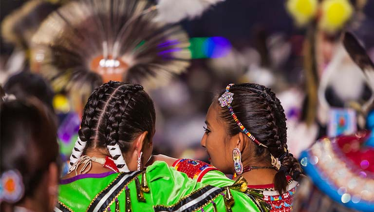 A photo of a Native American dancing