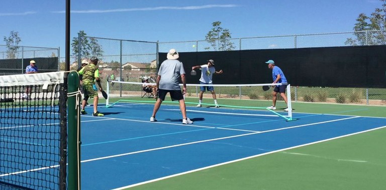 People playing pickleball in Albuquerque.