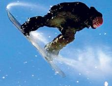 Image of a snowboarder floating through the air.