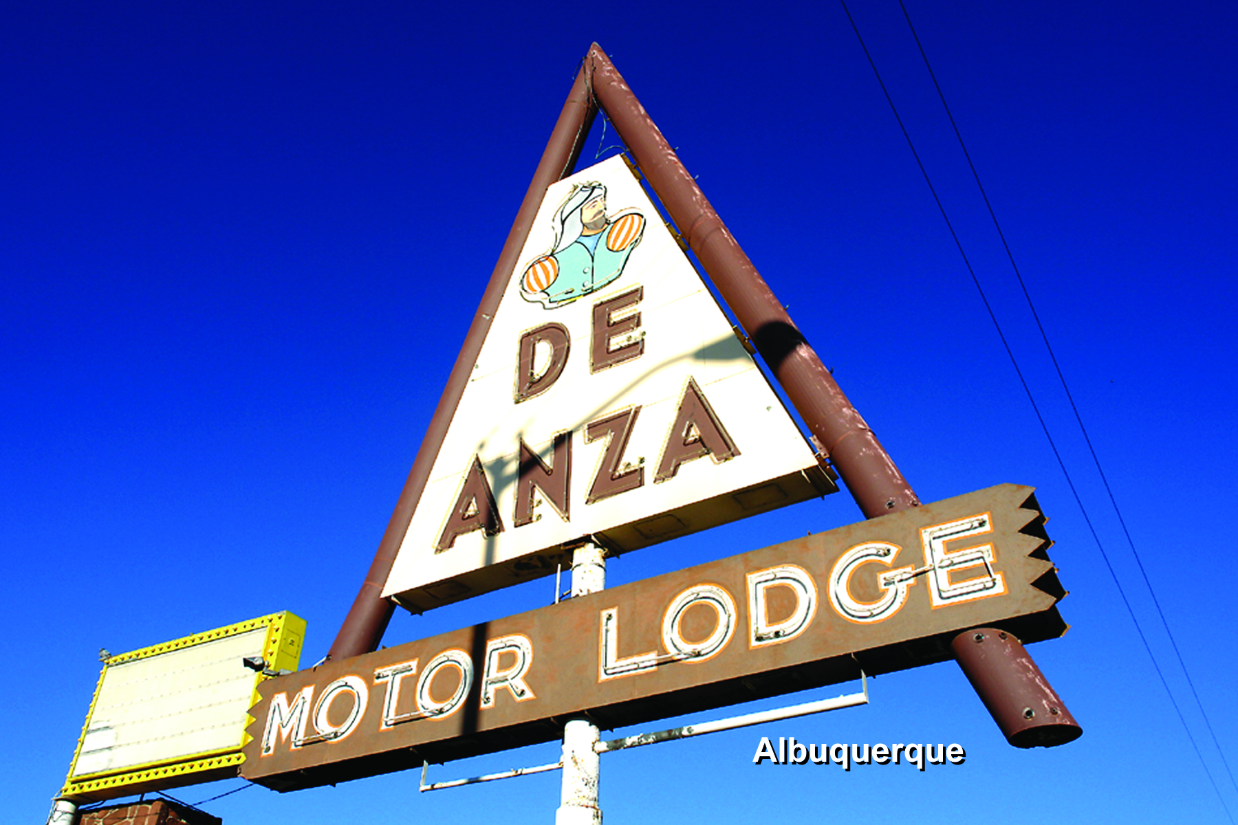 Photo showing the neon sign for the De Anza Motor Lodge.