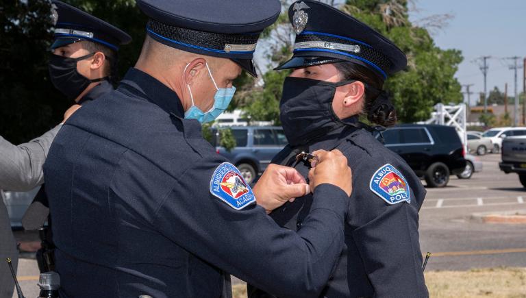 APD female officer during pinning ceremony