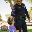 Officer Giving a Sticker to a Child