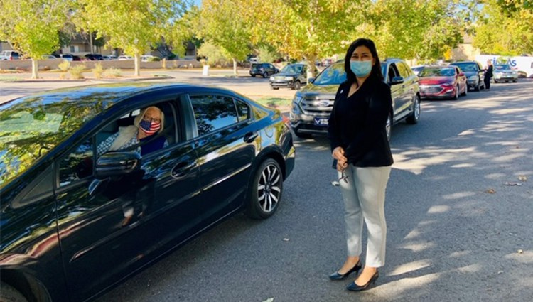 Senior Woman in Car with Senior Affairs Staff Member Standing Outside