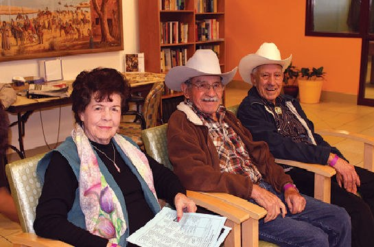 Image of friends gathered at the Barelas Senior Center.