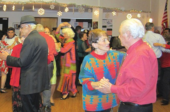 Image of couples dancing at the Barelas Senior Center.