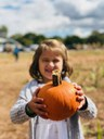 Youth with pumpkin