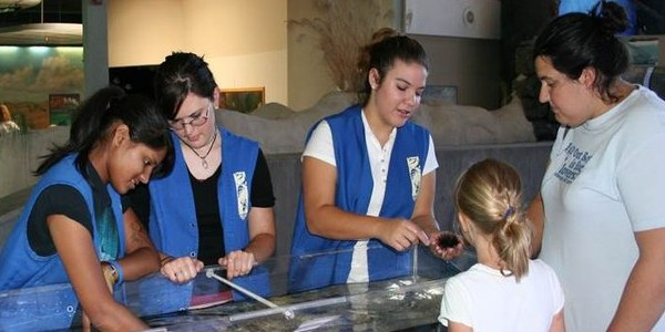 Teens and a family at a BioPark volunteer event.