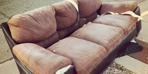An image of a couch scheduled for large item pickup.