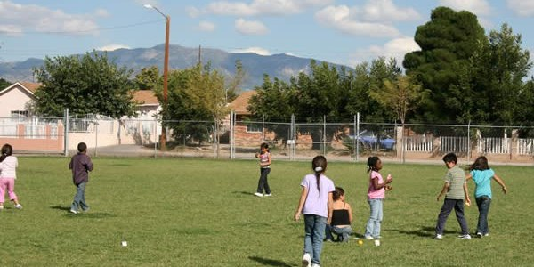 An image of children playing in a City park.