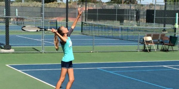 A photo of a person playing tennis.