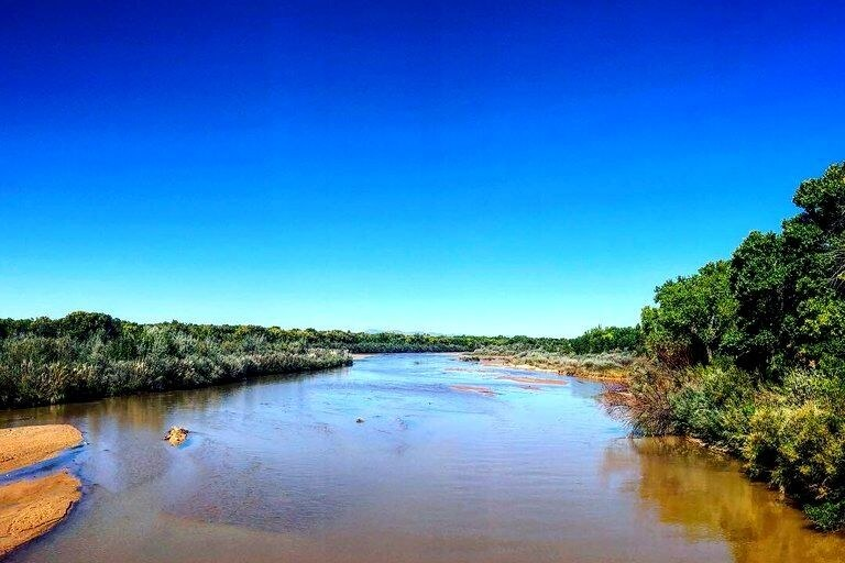 An image of the Rio Grande River and a clear blue sky.