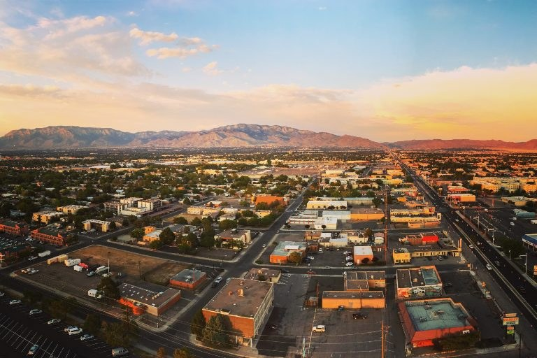 Albuquerque and the Sandia Mountains as seen from a drone high above the ground.