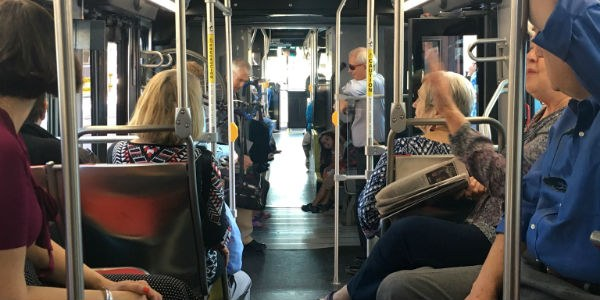 Passengers aboard the Rapid Transit bus.