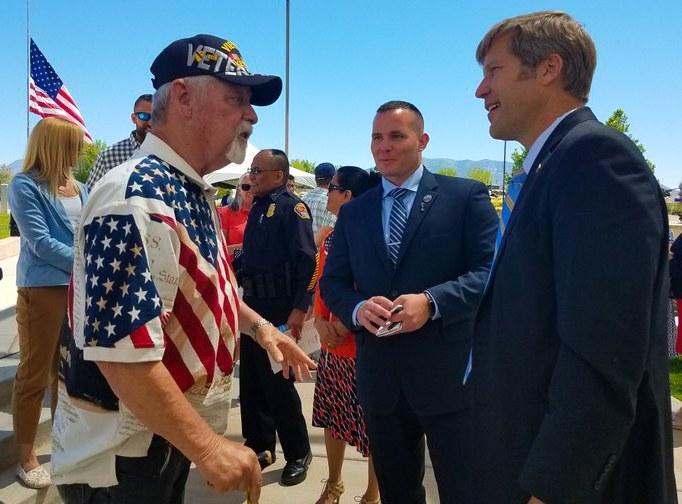 Mayor Keller conversing with a veteran