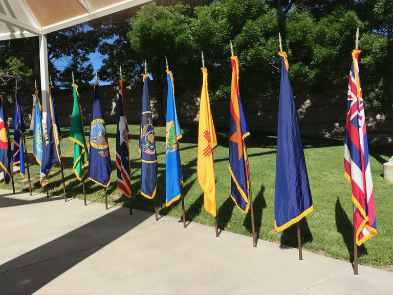 Military flags in front of the New Mexico Veterans Memorial.