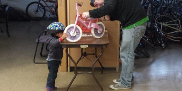 Esperanza Bike Shop Child and Bike Worker