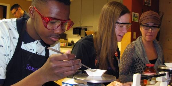 Students working on a science experiment at Explora.