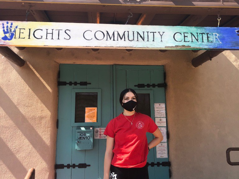 A recreation leader standing in front of the Heights Community Center