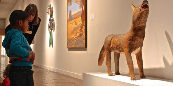 A child looking at a sculputre inside the Albuquerque Museum.